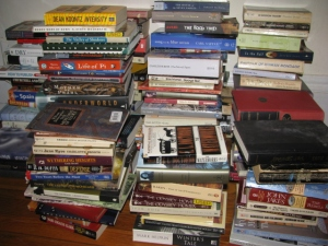 This photo was taken while I was organizing my shelves a few years back. Now the random piles are much smaller :)